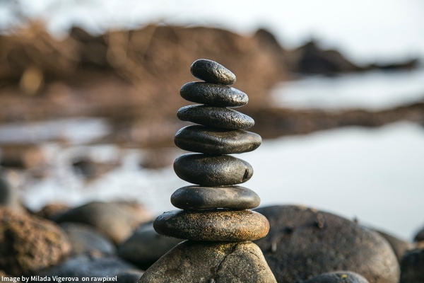 river rocks piled beside lakeshore