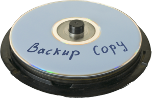stack of CDs with backup copy written on the top